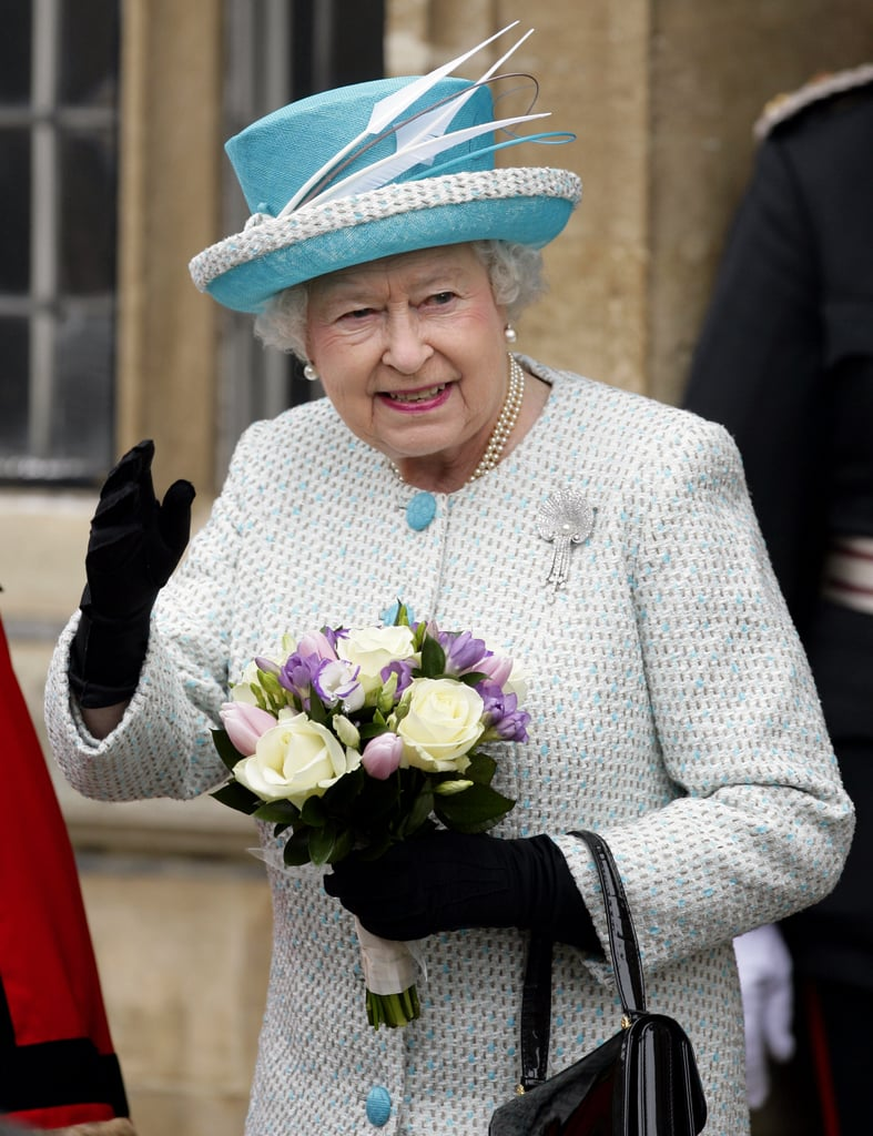 Queen Elizabeth carried flowers as she departed King's Lynn Town Hall as she celebrated Accession Day.