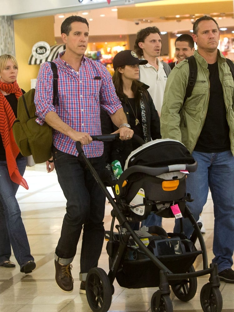 Reese Witherspoon and her husband, Jim Toth, took a flight out of Atlanta and landed in LA with their son Tennessee on Saturday night.