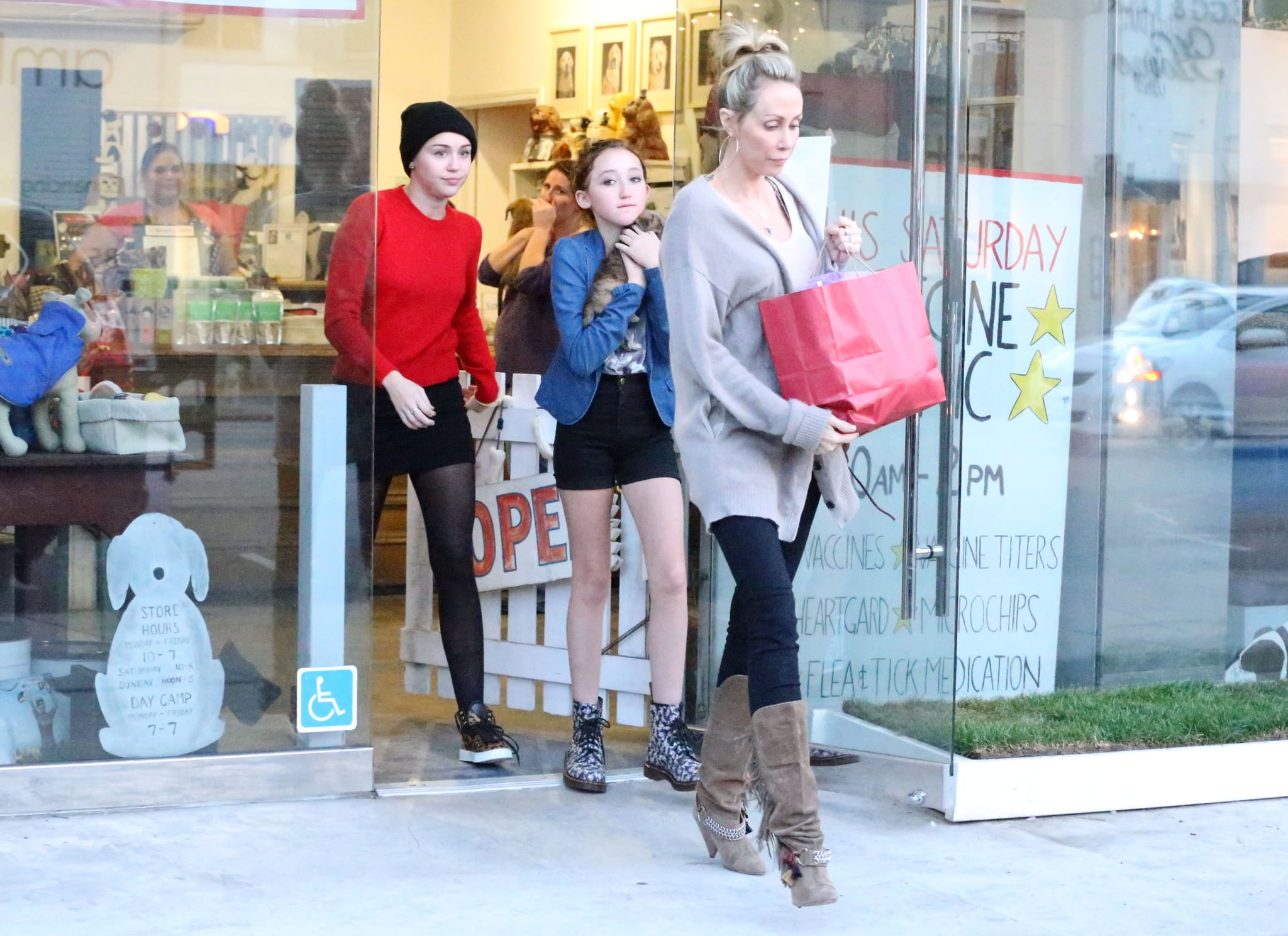 Miley Cyrus, her mom, and her sister left an LA pet store with a puppy.