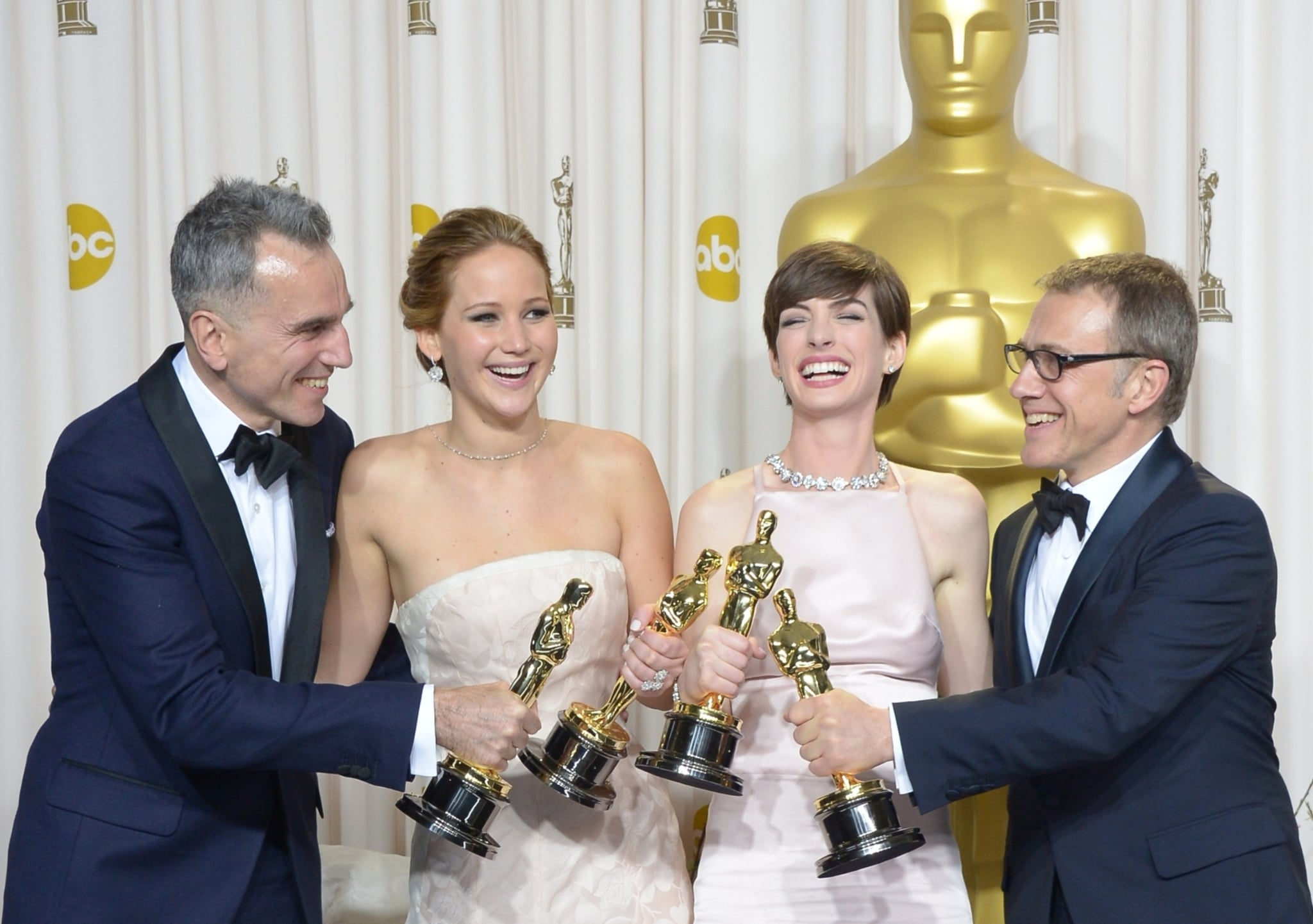 Daniel Day-Lewis, Jennifer Lawrence, Anne Hathaway, and Christoph Waltz toasted with their gold Oscars.