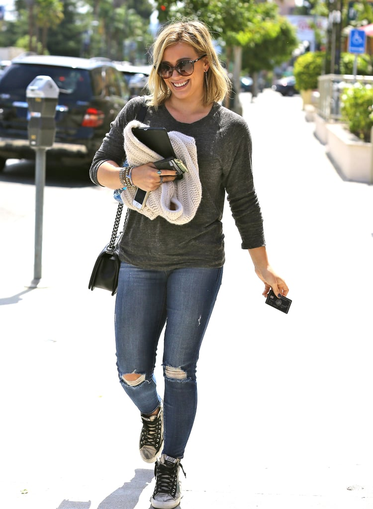 Hilary Duff juggled her things in LA on Thursday.