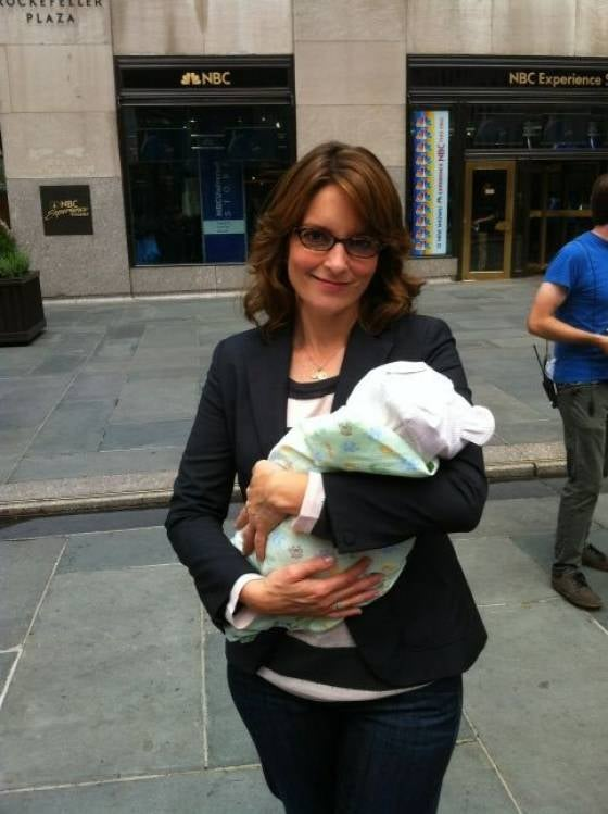 Tina Fey held a baby while filming 30 Rock. Source: Twitter user jackburditt