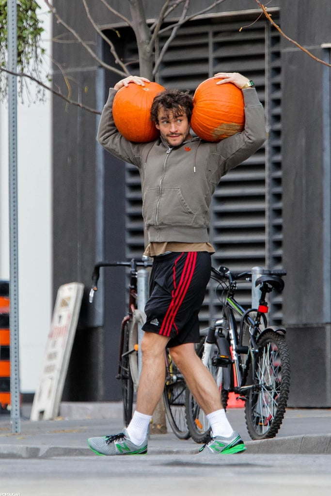 Hugh Dancy balanced two pumpkins on his shoulders in Toronto.