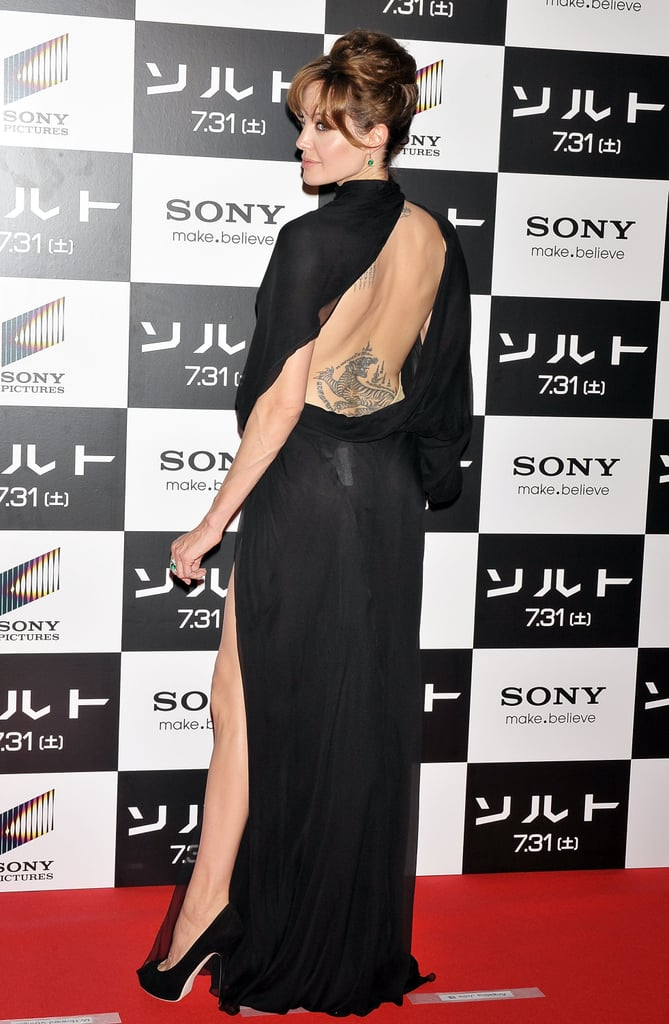 Angelina Jolie displayed her back tattoos at the July 2010 Tokyo premiere of Salt.