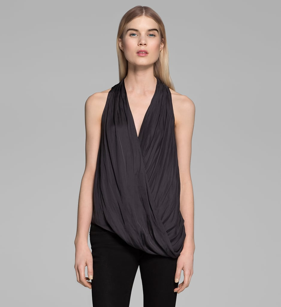 I can't get enough of this gorgeous draped Helmut Lang Glassy top ($195). It would look just as amazing under a blazer for work as it would later into the evening, worn alone with a pair of printed shorts and heels. — Chi Diem Chau
