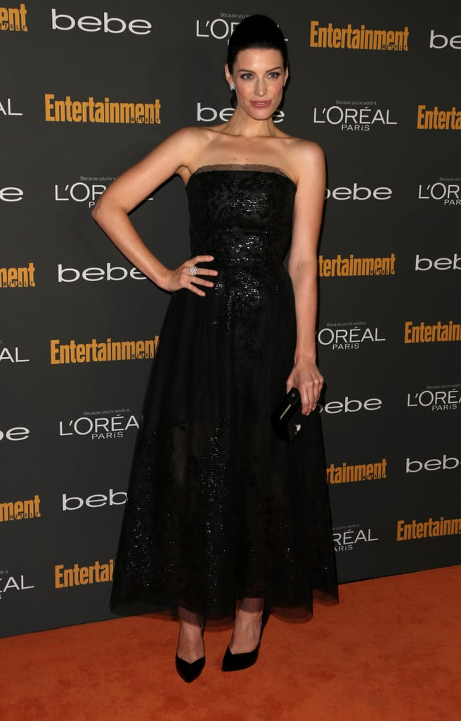 Jessica Paré kept it classic and chic in a black strapless midi gown by Oscar de la Renta and black accessories at the Entertainment Weekly pre-Emmys party in LA. She then added Norman Silverman diamond earrings and a Le Vian diamond ring for a hint of shine.