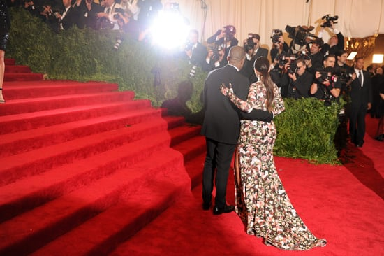 Kim Kardashian and Kanye West stopped for a photo op before making their way up the steps.