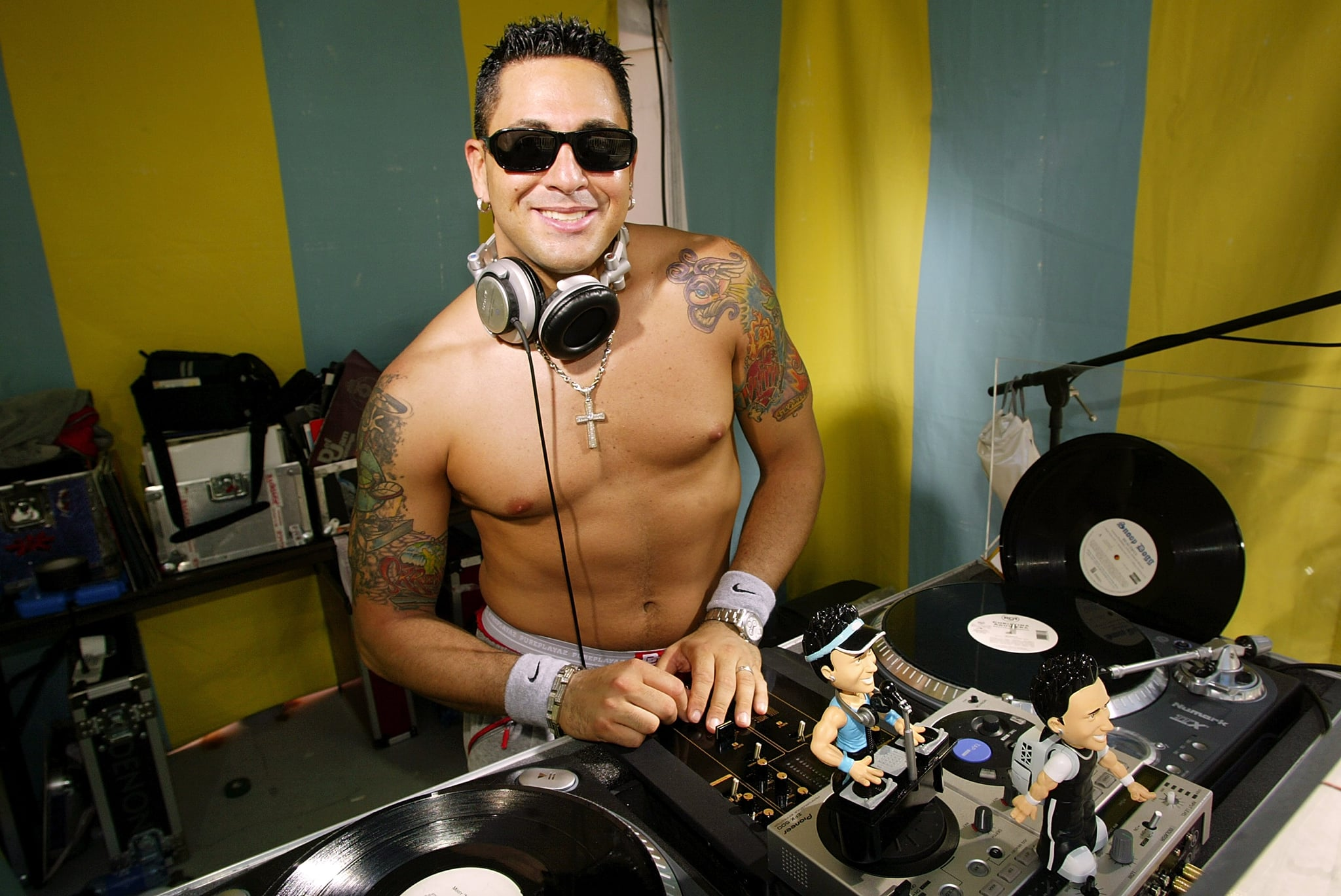 2003: Shirtless DJ Skribble spins on the ones and twos in Miami Beach.