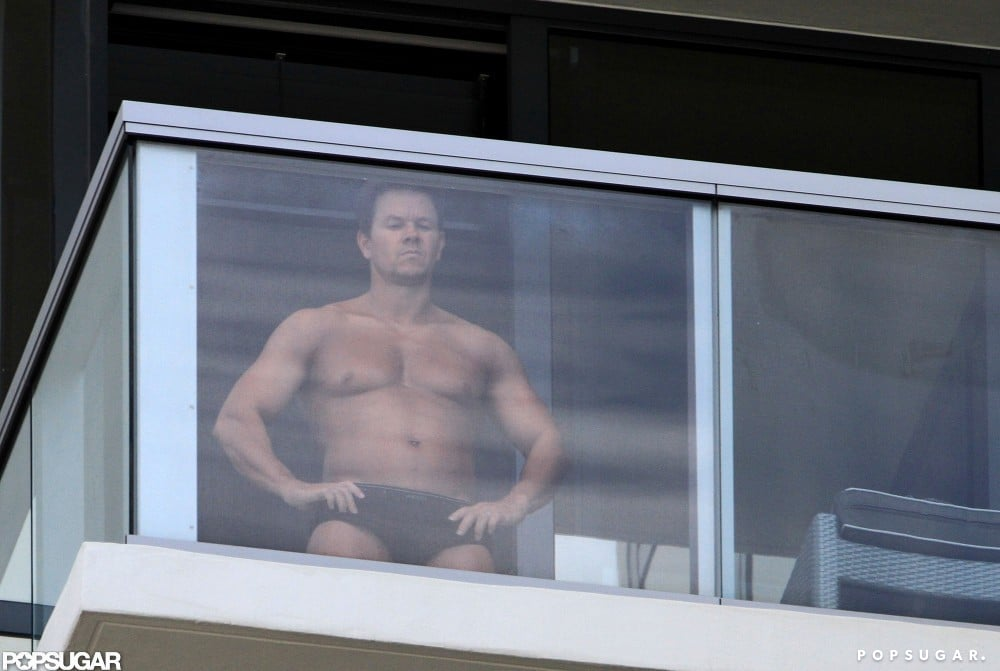 Mark Wahlberg was shirtless on his balcony in Miami for a spray tan.