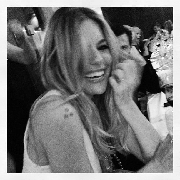 Sienna Miller laughed and smiled during a Chanel event. Source: Instagram user poppydelevingne