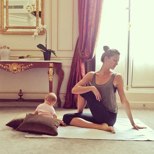 """Gisele Bündchen shared a sweet photo while practicing yoga with her """"little partner,"""" baby daughter Vivian. Source: Instagram user giseleofficial"""