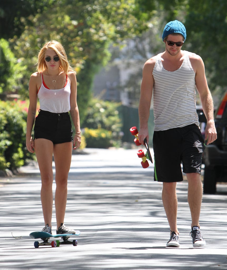 Miley Cyrus and Liam Hemsworth went on a skate date around an LA neighborhood together in July 2012.