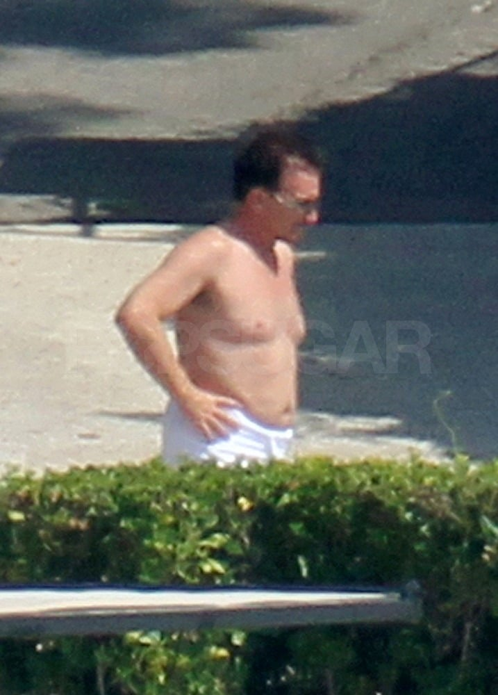 Bono stripped off his shirt for a day on the lake.