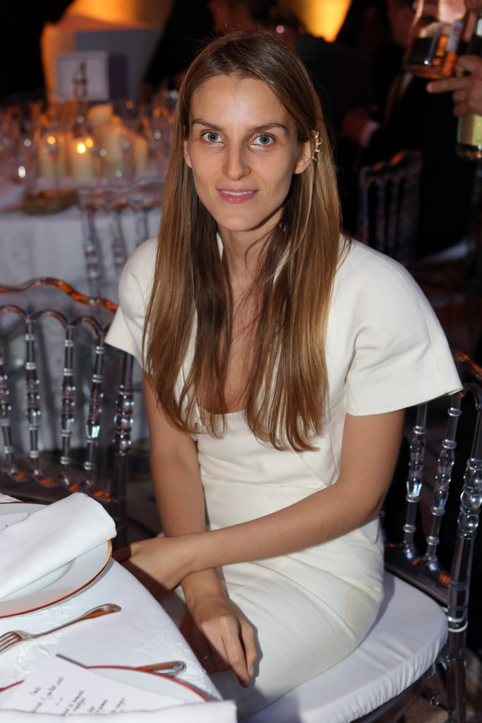 At Fendi's private dinner, Gaia Repossi styled her edgy jewelry designs with a white sheath. Source: