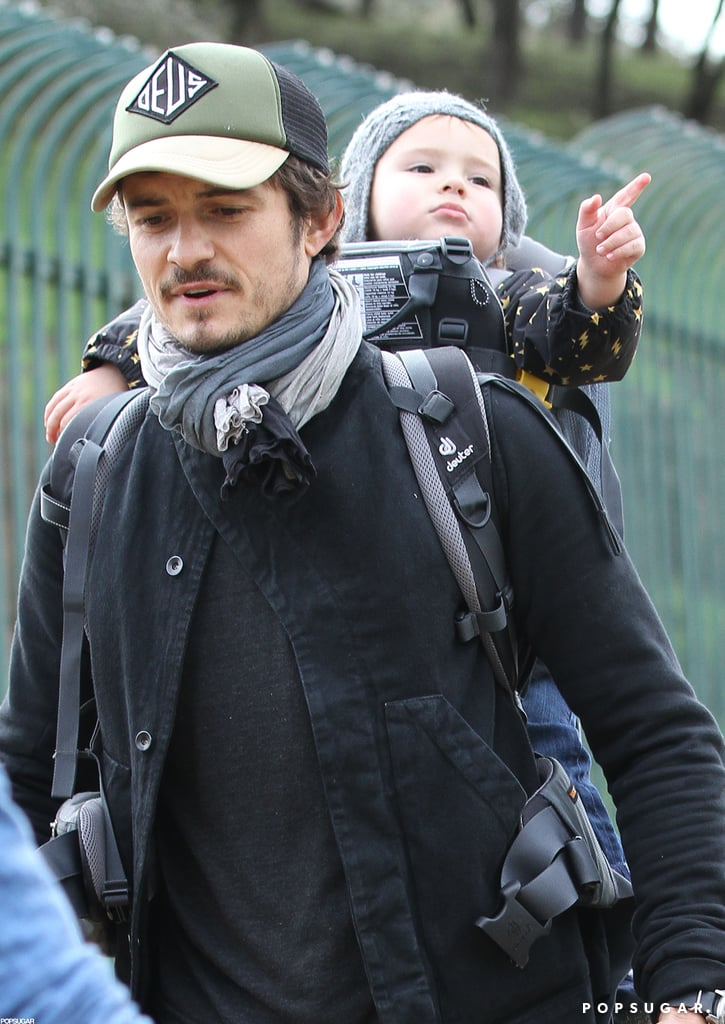 Flynn Bloom pointed as he hiked with Orlando Bloom.
