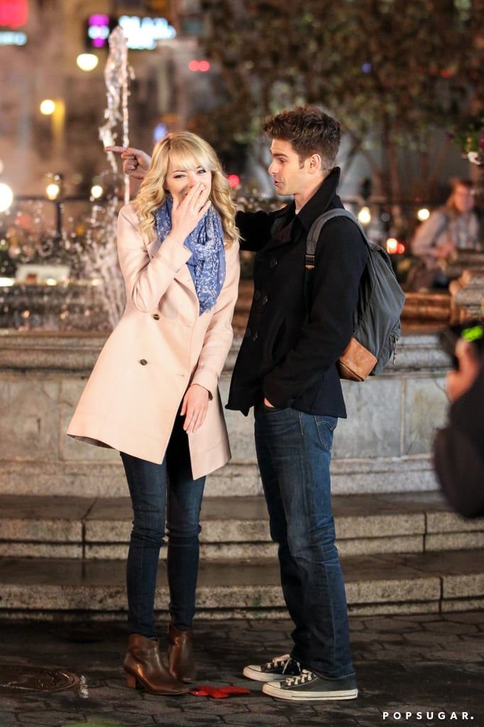 Emma Stone and Andrew Garfield giggled on set while filming The Amazing Spider-Man 2 in NYC.