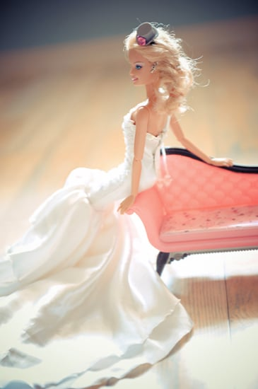Barbie leans against the chaise lounge. Photo by BdG Photography via Rock n Roll Bride