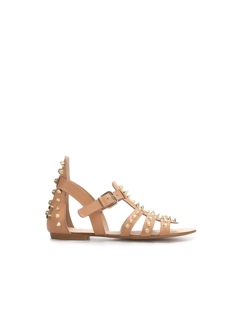 Gold studs toughen up these neutral gladiator-style sandals — a great, unexpected option for your everyday.  Zara Sandal Strikeouts ($80)