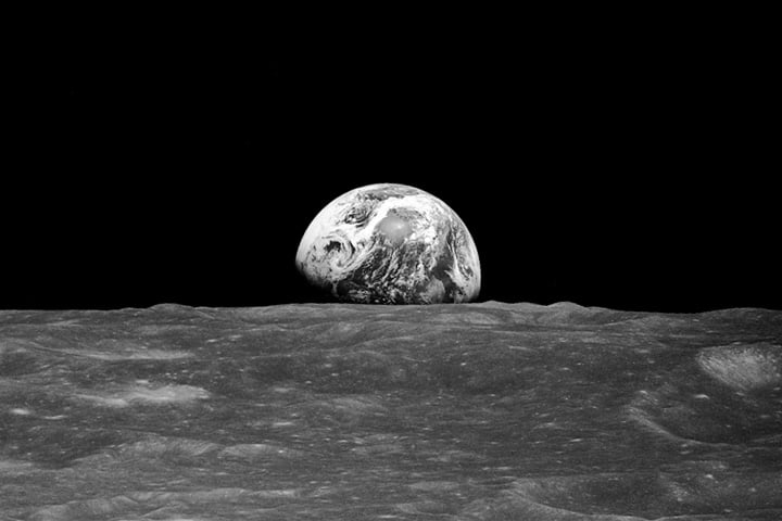 "Here we see the well-known ""Earthrise"" photo taken on the Apollo 8 mission. As NASA explains it, ""On Dec. 24, 1968, Apollo 8 astronauts Frank Borman, James Lovell, and William Anders were coming around from the far side of the Moon on their fourth orbit. Borman began to roll the spacecraft, and as he did, the Earth rose into view over the Moon's limb. Anders, photographing the Moon from the right side window, caught sight of the view and exclaimed: 'Oh, my God, look at that picture over there! There's the Earth comin' up. Wow, is that pretty!' He snapped a black-and-white photo, capturing humanity's first view of Earth from another planetary body.""  Source: Bill Anders/NASA"