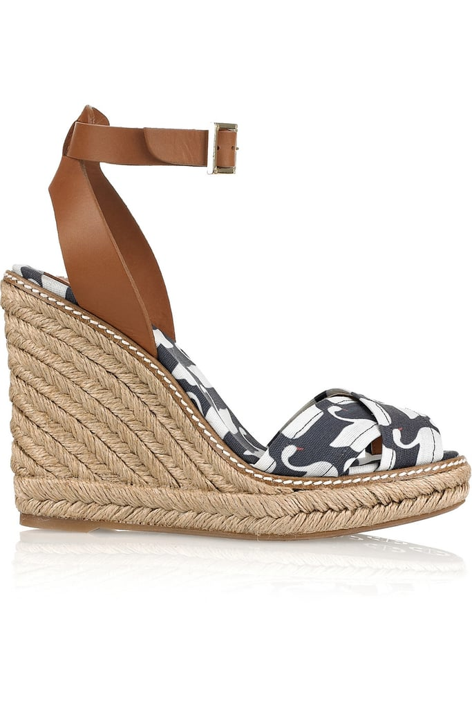 The Quintessential Wedge Sandal No Spring/Summer shoe collection is complete without an espadrille-inspired variation. In this case, we love this quirky swan print paired up with a slick ankle strap and rope wedge detail. These sandals will look super cute with a breezy minidress, a pair of jeans, or even chino trousers.  Tory Burch Swan-Print Wedge Sandals ($105, originally $175)