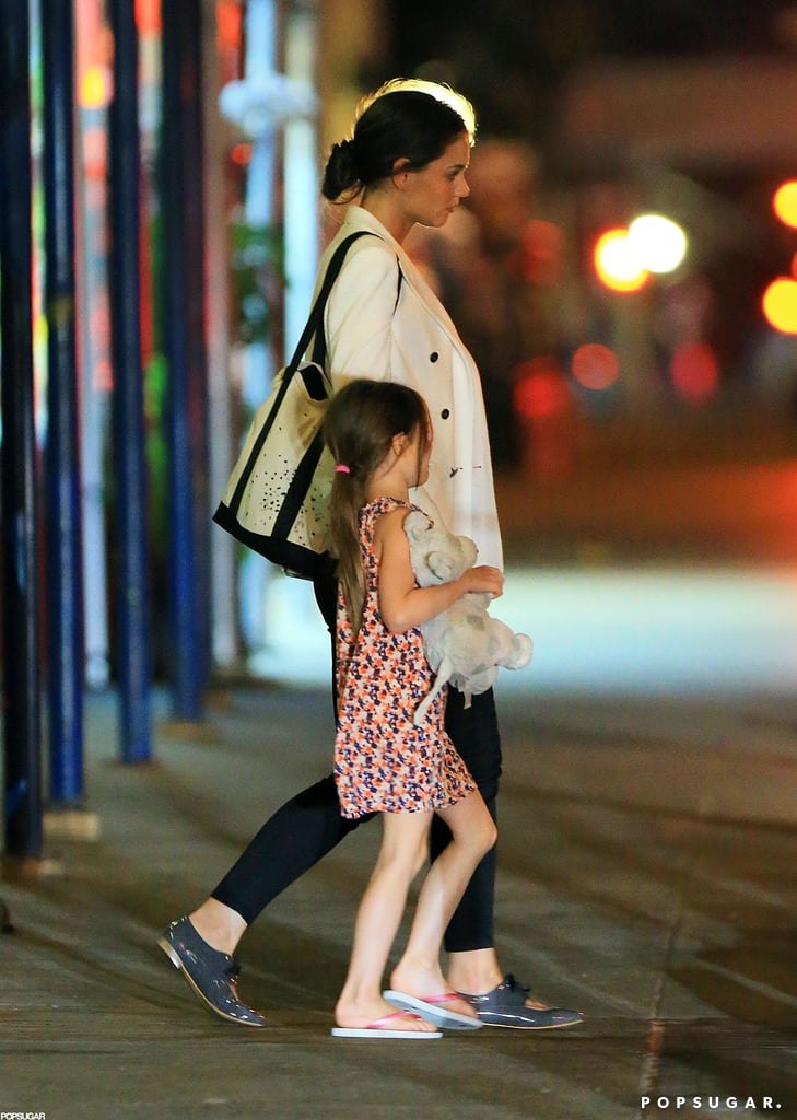 Katie Holmes held Suri's hand on their way into dinner at Nobu.