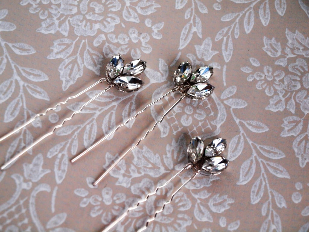 Place a few rhinestone hairpins ($29) into your coif for a modern art deco feel.