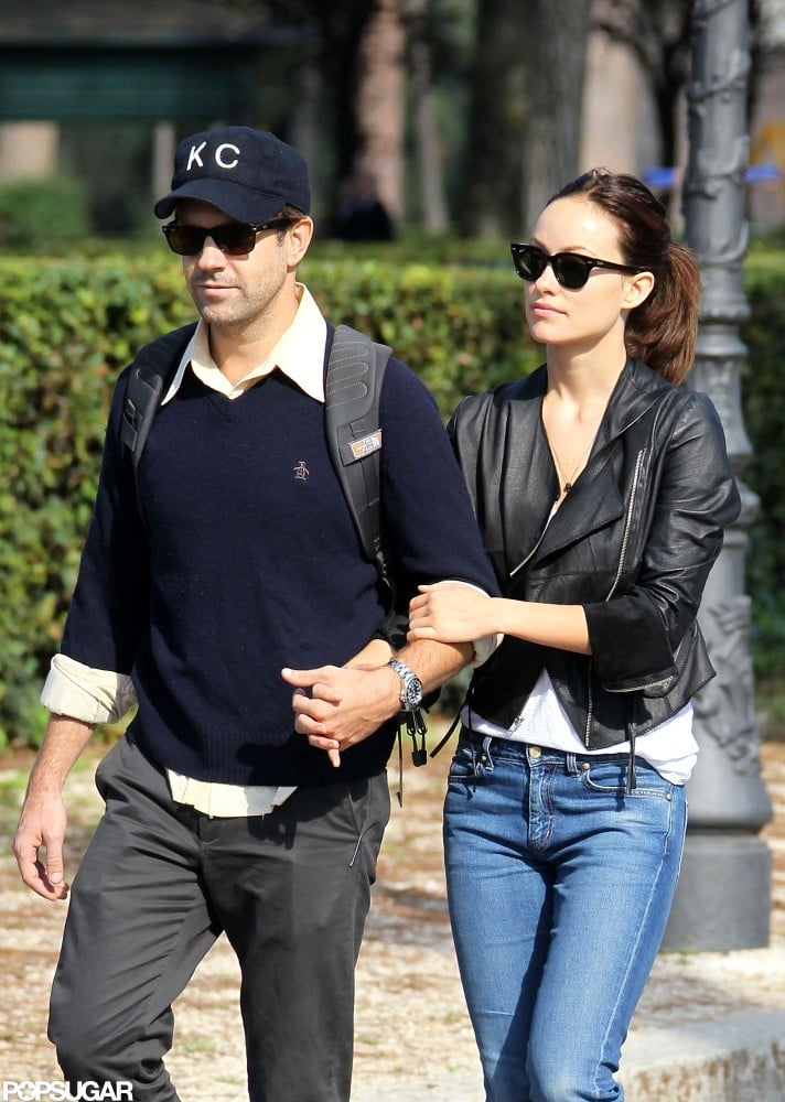 Olivia Wilde and Jason Sudeikis had their arms looped around each other.