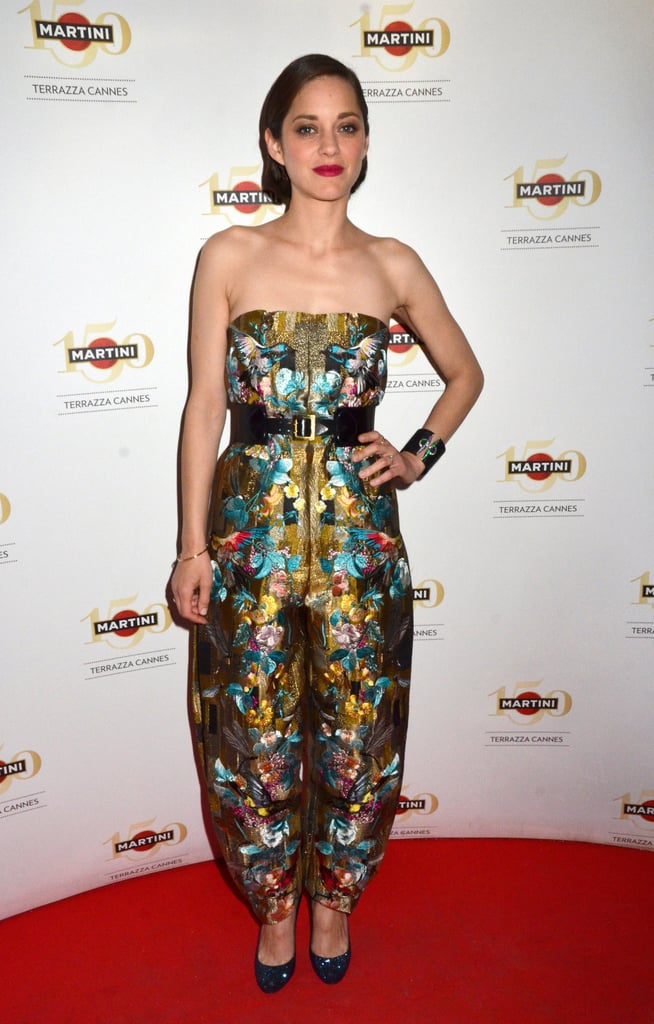 Marion Cotillard gave the gowns a break, reaching for an embroidered Alexander McQueen Spring 2013 jumpsuit for a Crash Magazine party.