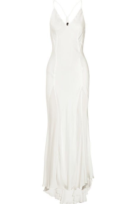 If your dress is more conservative for the ceremony, slip into a slinky gown like this for the reception. It's simple, but it'll hug your curves and offer a totally sexy vibe for dancing the night away at the afterparty.  Theyskens' Theory Djida Silk Gown ($277, originally $790)