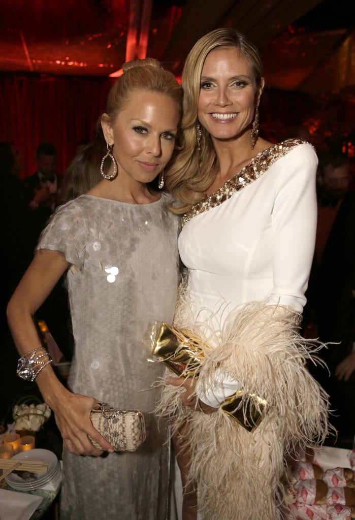 Fashionistas Rachel Zoe and Heidi Klum posed for pictures, flaunting their Golden Globe accessories.
