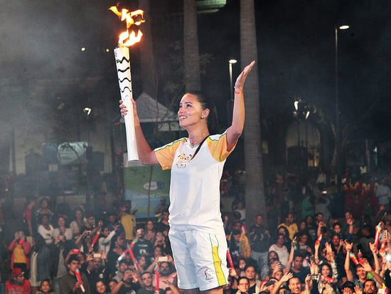 Adriana Lima Cries with Pride as She Carries the Olympic Torch Through the Streets of Rio