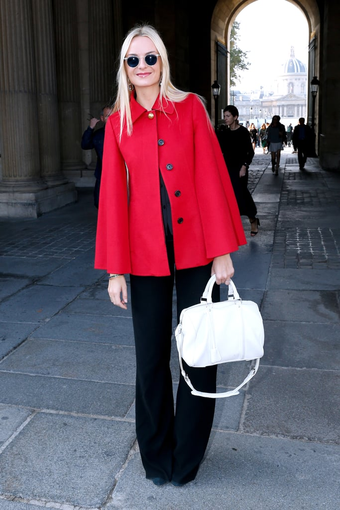 Virginie Courtin Clarins brightened up her dark ensemble with a pop of red cape outside the Louis Vuitton show.