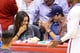 Mila giggled at Ashton as he snapped her photo at a March 2014 Clippers game in LA.
