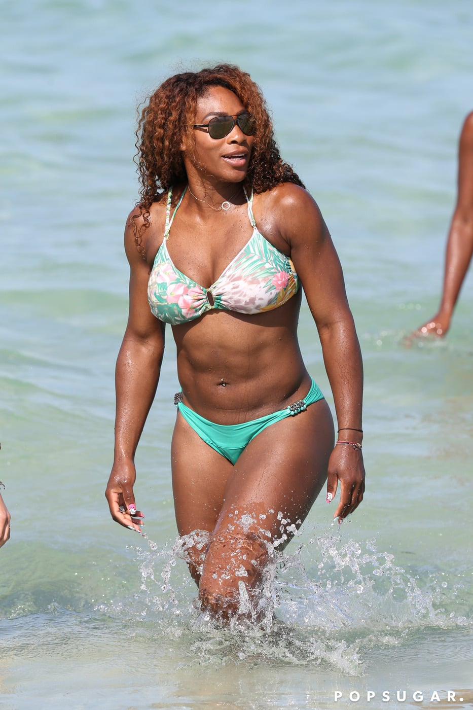 Serena Williams wore a green and floral two-piece.