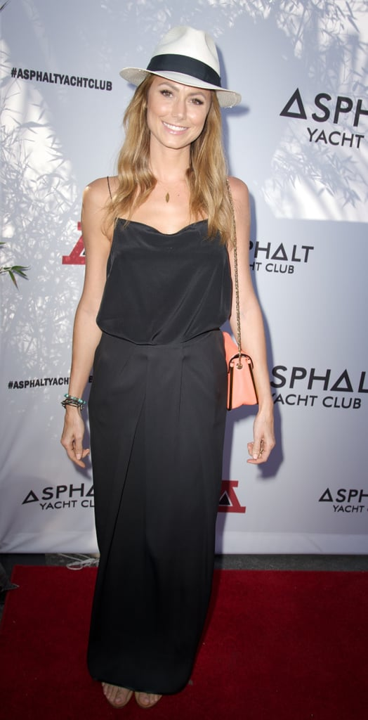 Stacy Keibler made her black maxi dress more summery with a fedora and peachy purse at a yacht party in Malibu.