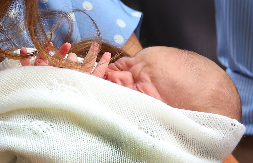 The royal baby was introduced to the world as the Duke and Duchess of Cambridge left the hospital.