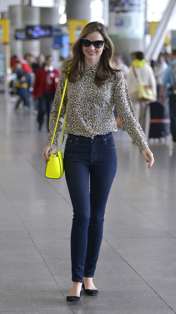 Miranda put her wild side on display in a leopard-print button-down upon arriving at JFK airport in NYC. Then, as if her top wasn't bold enough, she threw on a neon yellow Michael by Michael Kors bag for further flash.