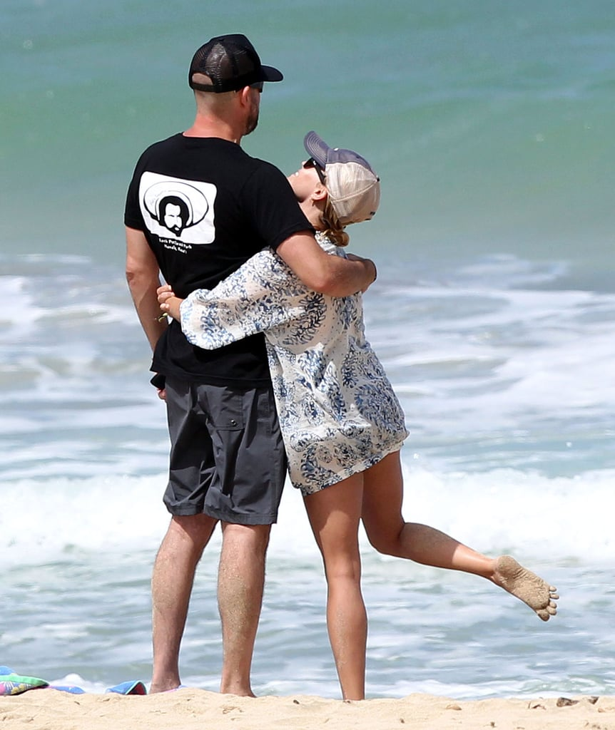 Reese Witherspoon showed Jim Toth love on the beach in Kauai during an Aug. 2011 trip.