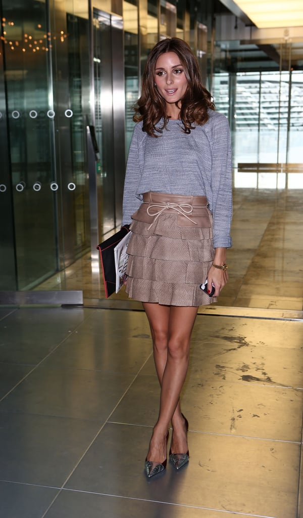 Olivia Palermo worked her styling magic on a tiered leather skirt, an easy knit, and metallic pumps at Matthew Williamson's show.
