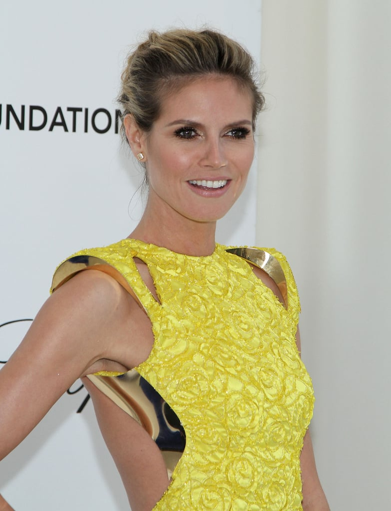 A close-up of Heidi Klum's side view reveals a metallic detailing along the bust line.