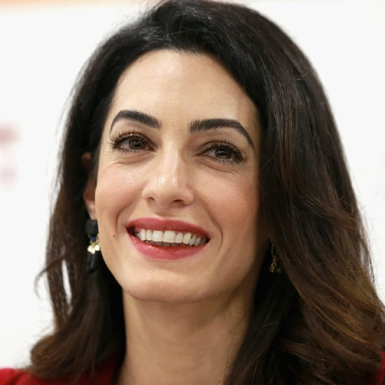 Amal Clooney Wearing a Red Suit