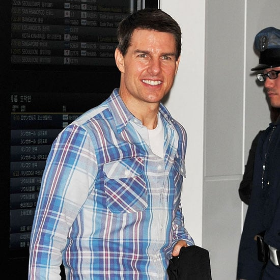 Tom Cruise was a happy traveler.
