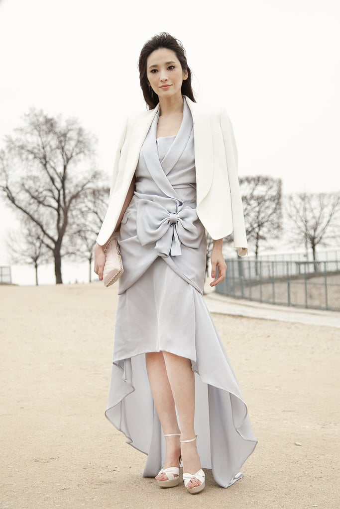An ultrafeminine bow-tied dress topped off with a sleek blazer outside the shows.