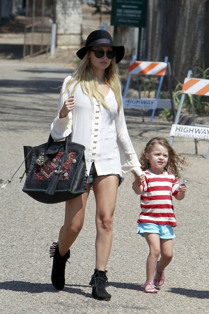 Harlow wore Summer sandals while Nicole stepped out in suede boots.