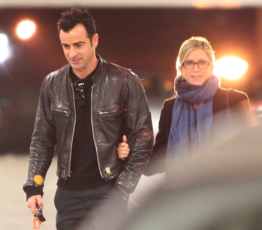 Jennifer Aniston and Justin Theroux left a movie.