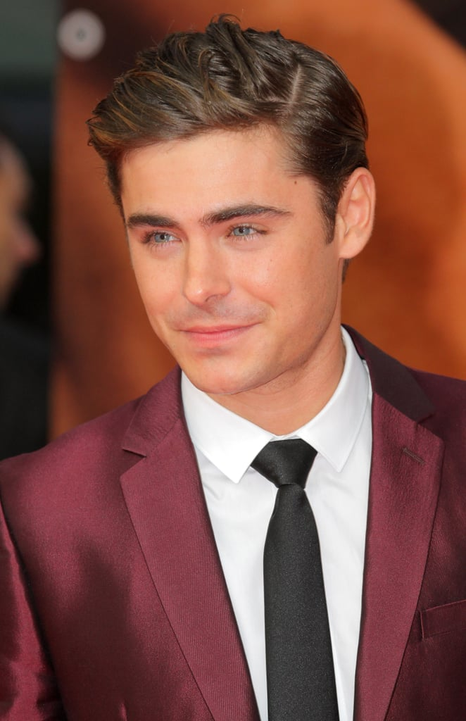 ZAc Efron wore a maroon suit and black tie to the Berlin premiere of The Lucky One.