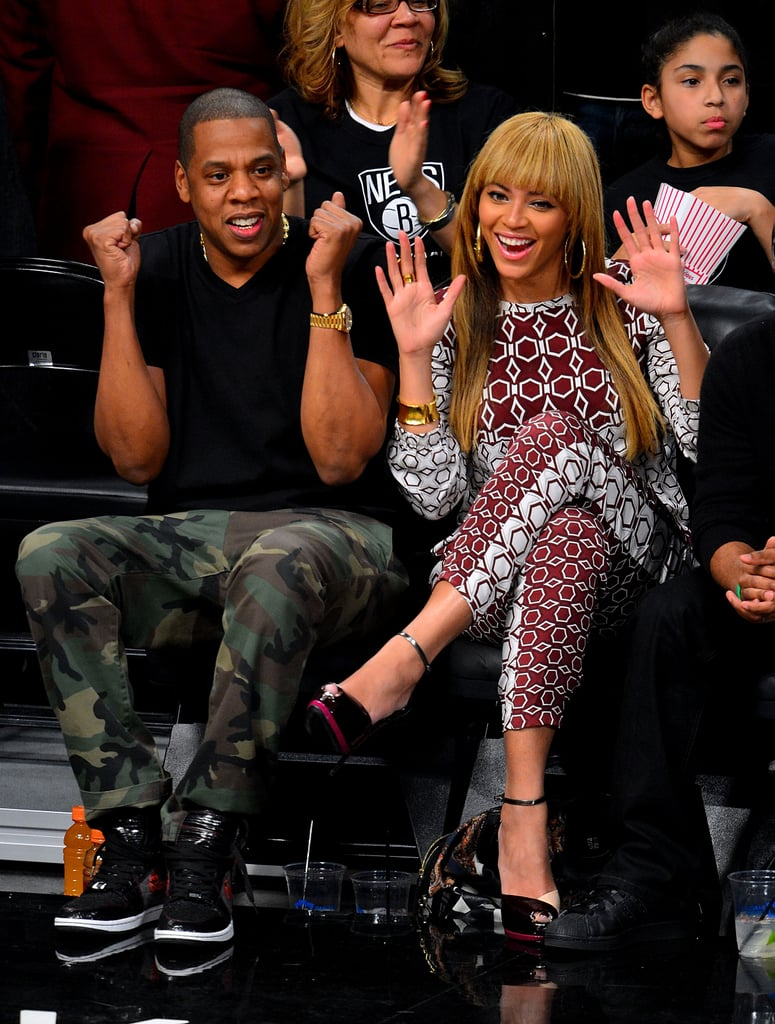 Beyoncé chose a head-to-toe printed Tibi ensemble while Jay Z styled camouflage pants with a black tee for a courtside appearance in November 2012.
