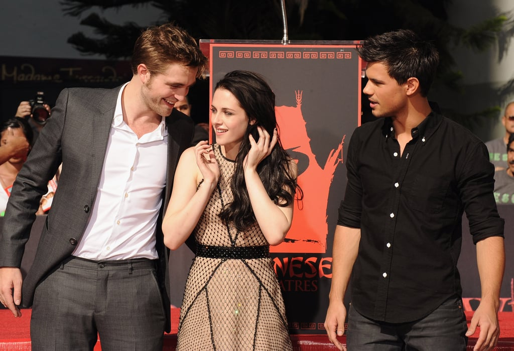 Kristen Stewart, Robert Pattinson, and Taylor Lautner talked amongst themselves before signing their plaque on the Walk of Fame.