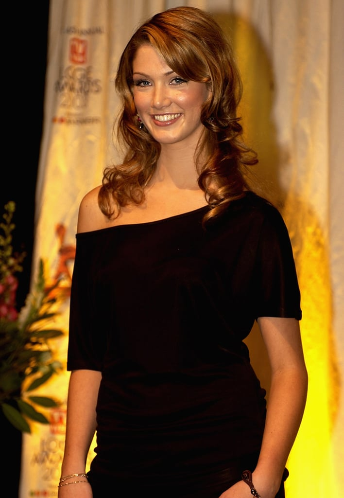 Young Delta posed at a photo call for the 2003 Logie Awards.