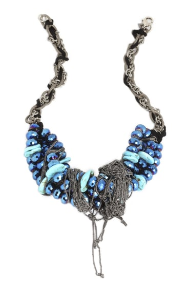 Bright blue crystals wrapped in chains make this Dannijo Isadore necklace ($695) look like it was literally pulled out from a mess of treaure.